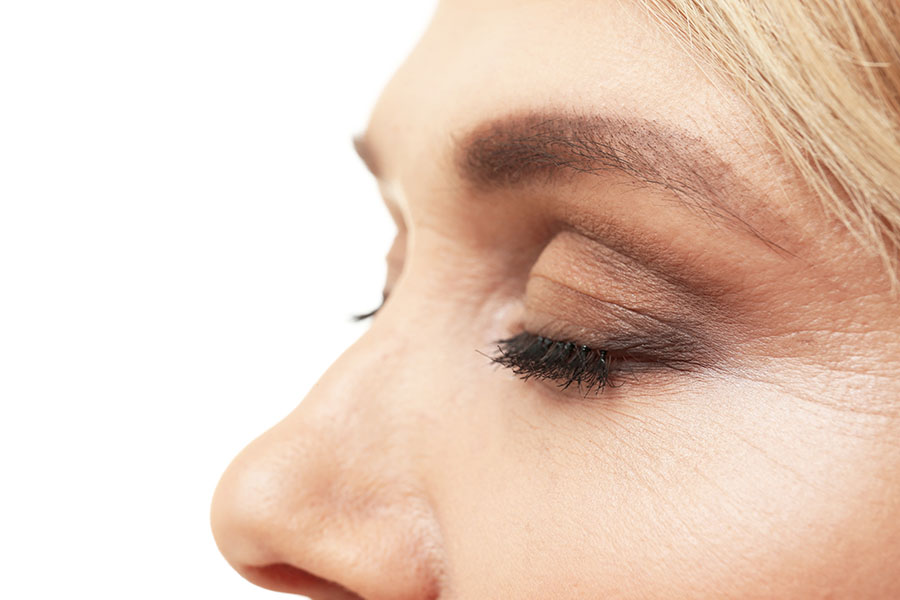 Woman With Eyes Closed Showing Fine Lines